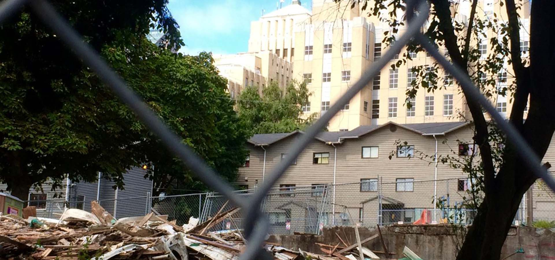 Demolition of a building with the debris on the ground.