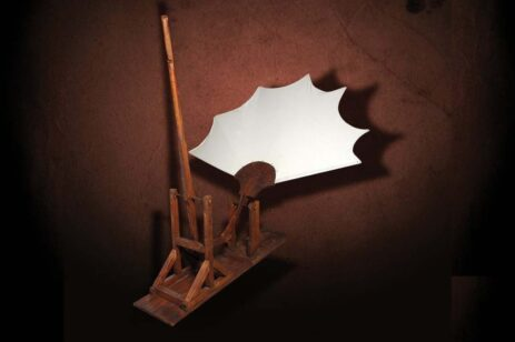 Graphic of one of Leonardo DaVinci's inventions made of wood and with a white sail or screen.