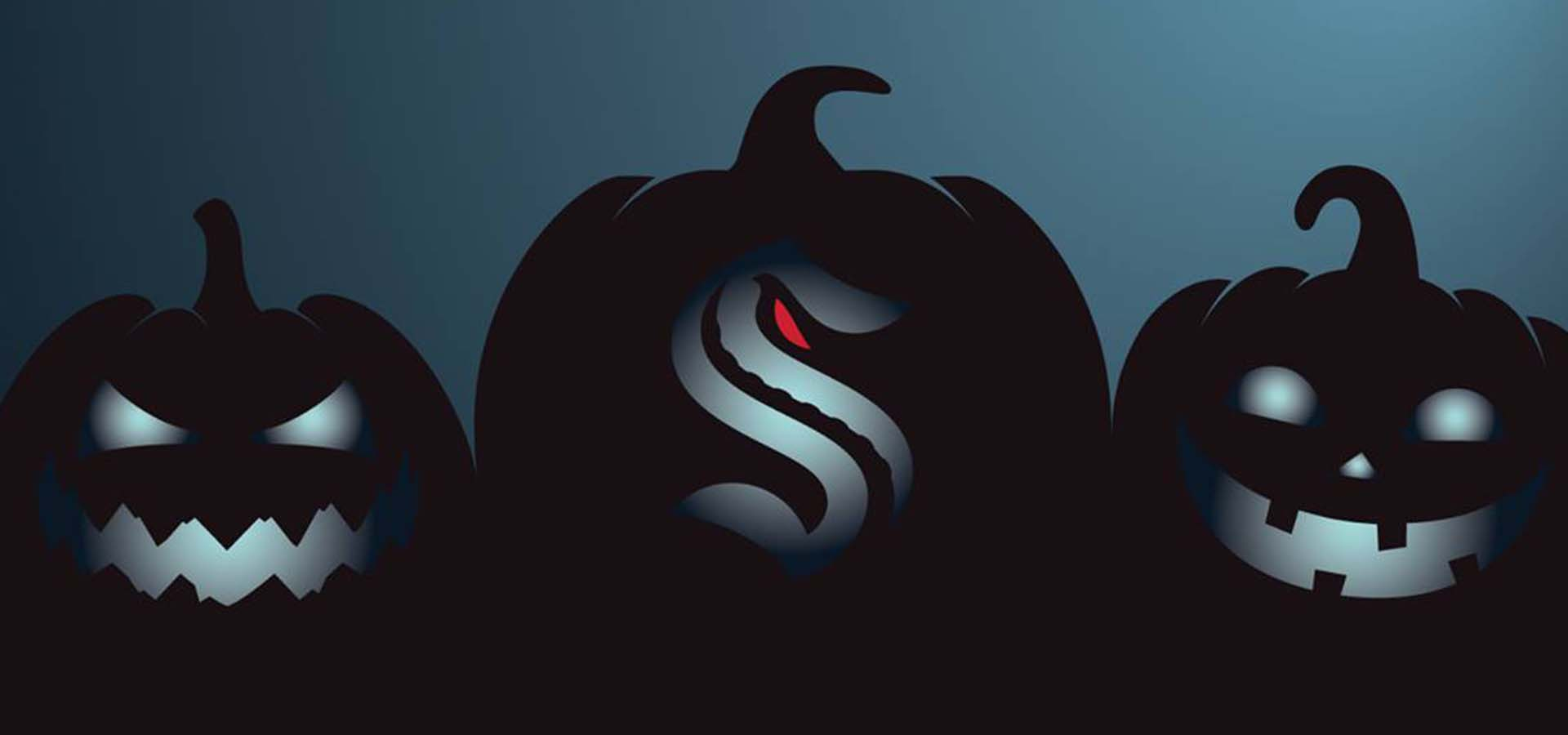 Night colors with black pumpkins carved with NHL Seattle Kraken logos in them