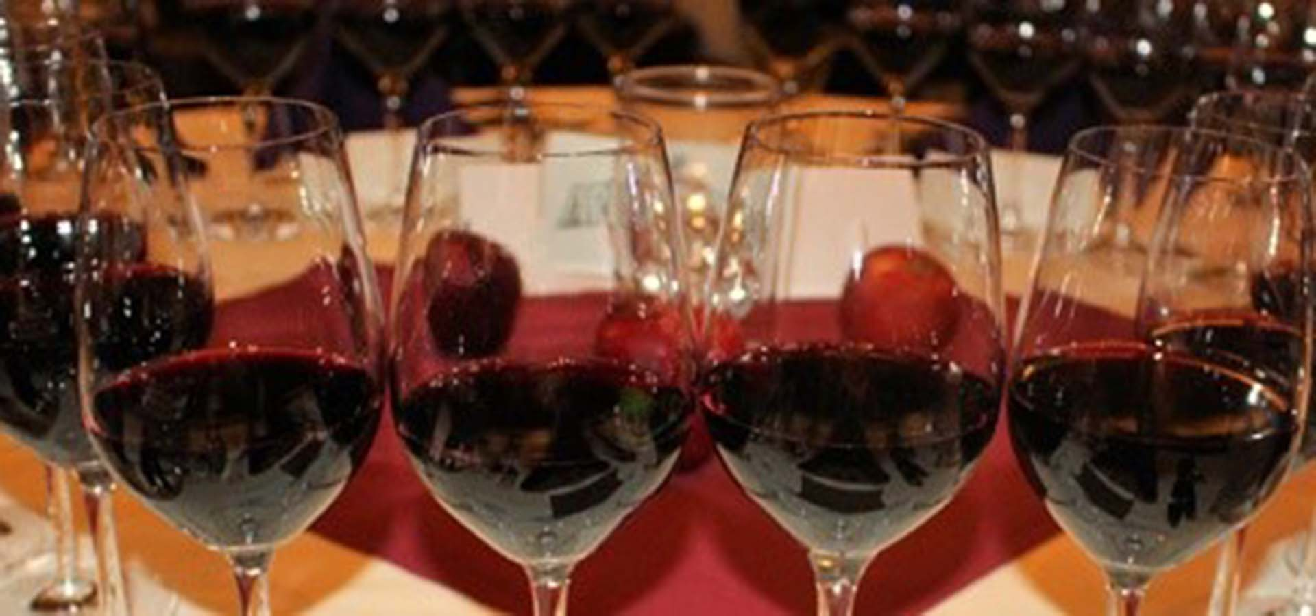 Table full of glasses of red wine.