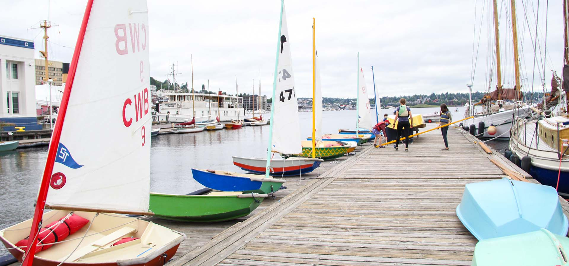 Row of small boats moored at a dock