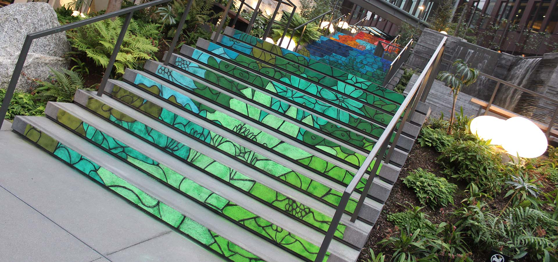 Chalk art by artist Josephine Rice on exterior steps at Amazon's Re:Invent building