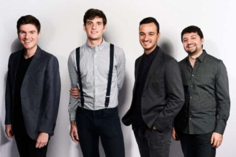 Portrait of percussion band, Sandbox Percussion, which is 4 male members.