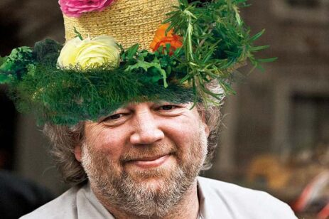 Chef Tom Douglas wearing a vegetable straw hat.