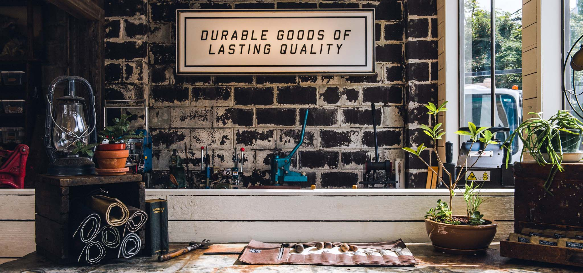 Interior of Hardmill shop, with leather goods, tools, and complimentary products.
