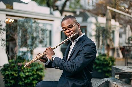 African-American man playing a flute