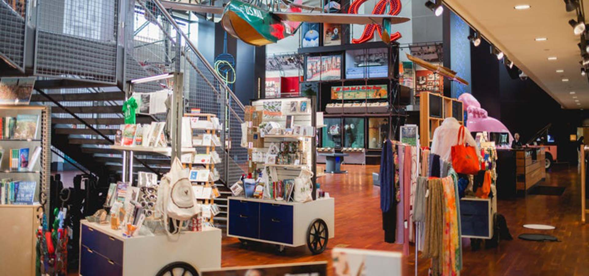 Interior view of the MOHAI Mercantile shop; view has kiosks filled with books, cards, and souvenirs.
