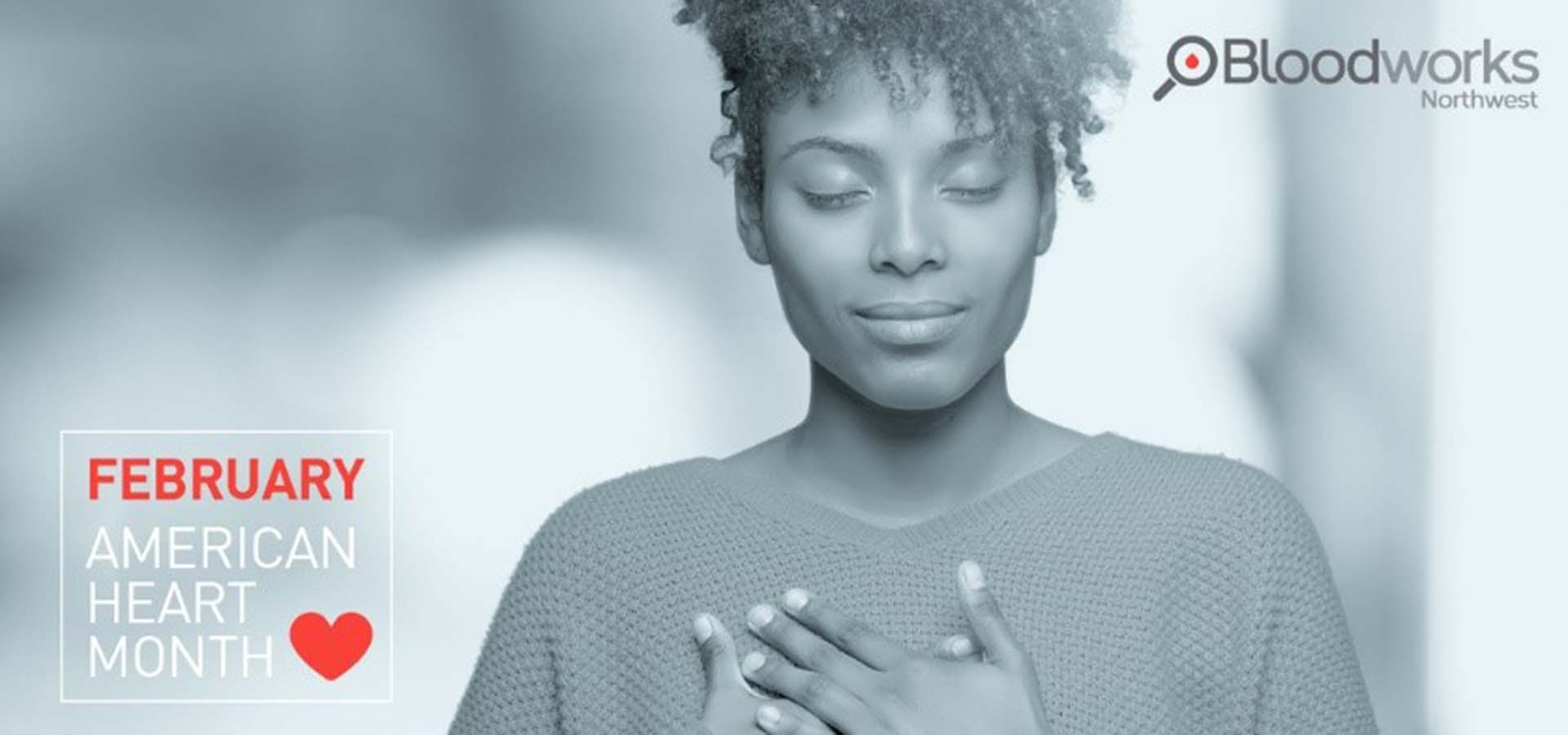Black and white photo of a woman with her hand over her heart; for February Heart Month.
