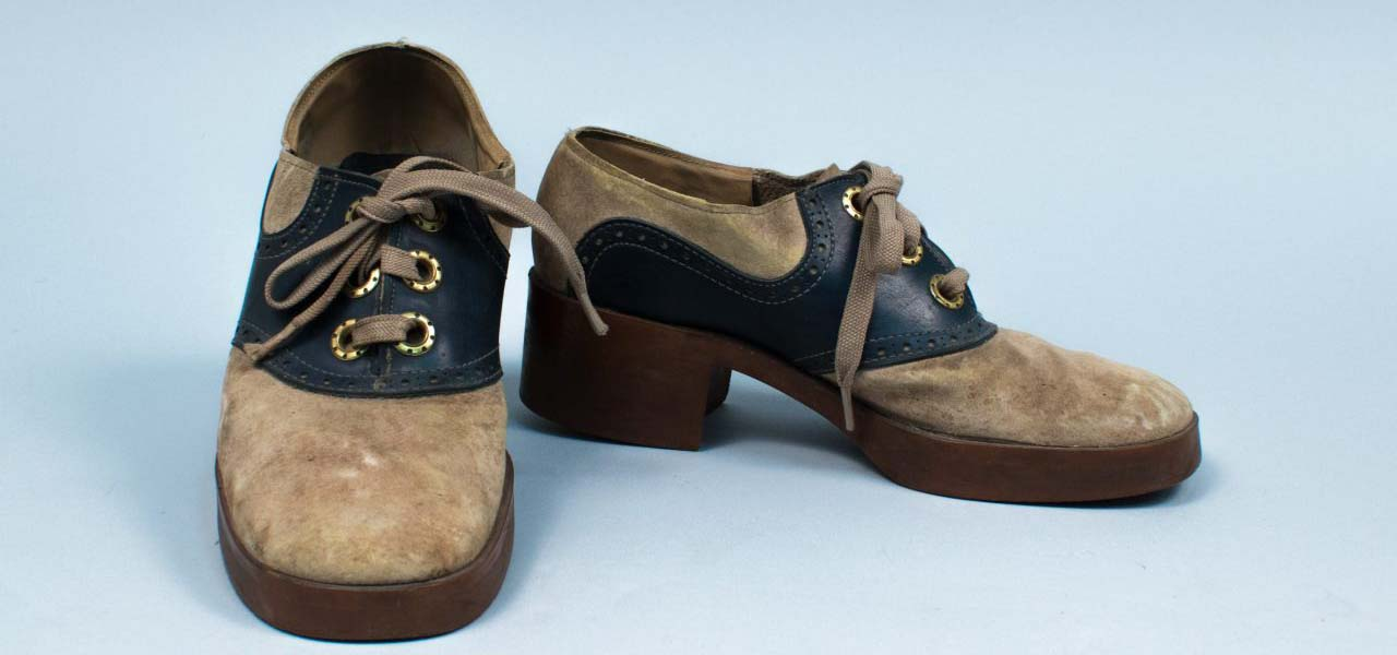 A pair of worn platform bowling shoes.