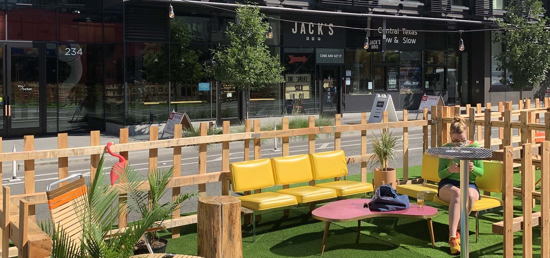 Outdoor street eatery set up with patio furniture