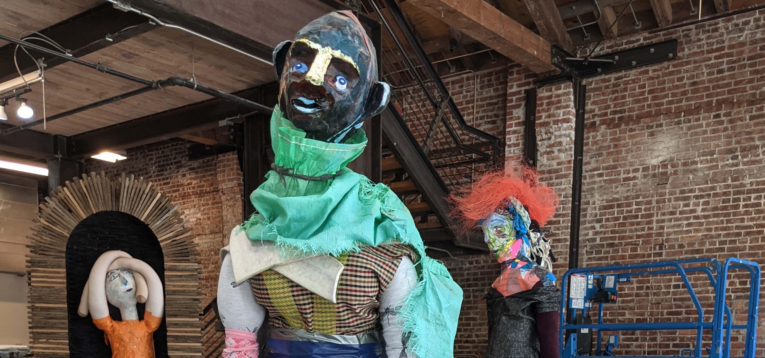 Modern art human-like sculptures made from recycled construction materials.