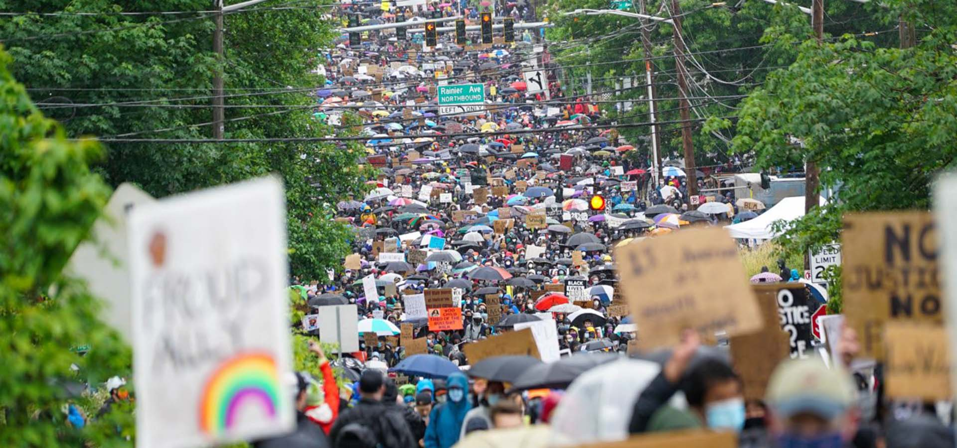 Down-street view of a protest with thousands of attendees