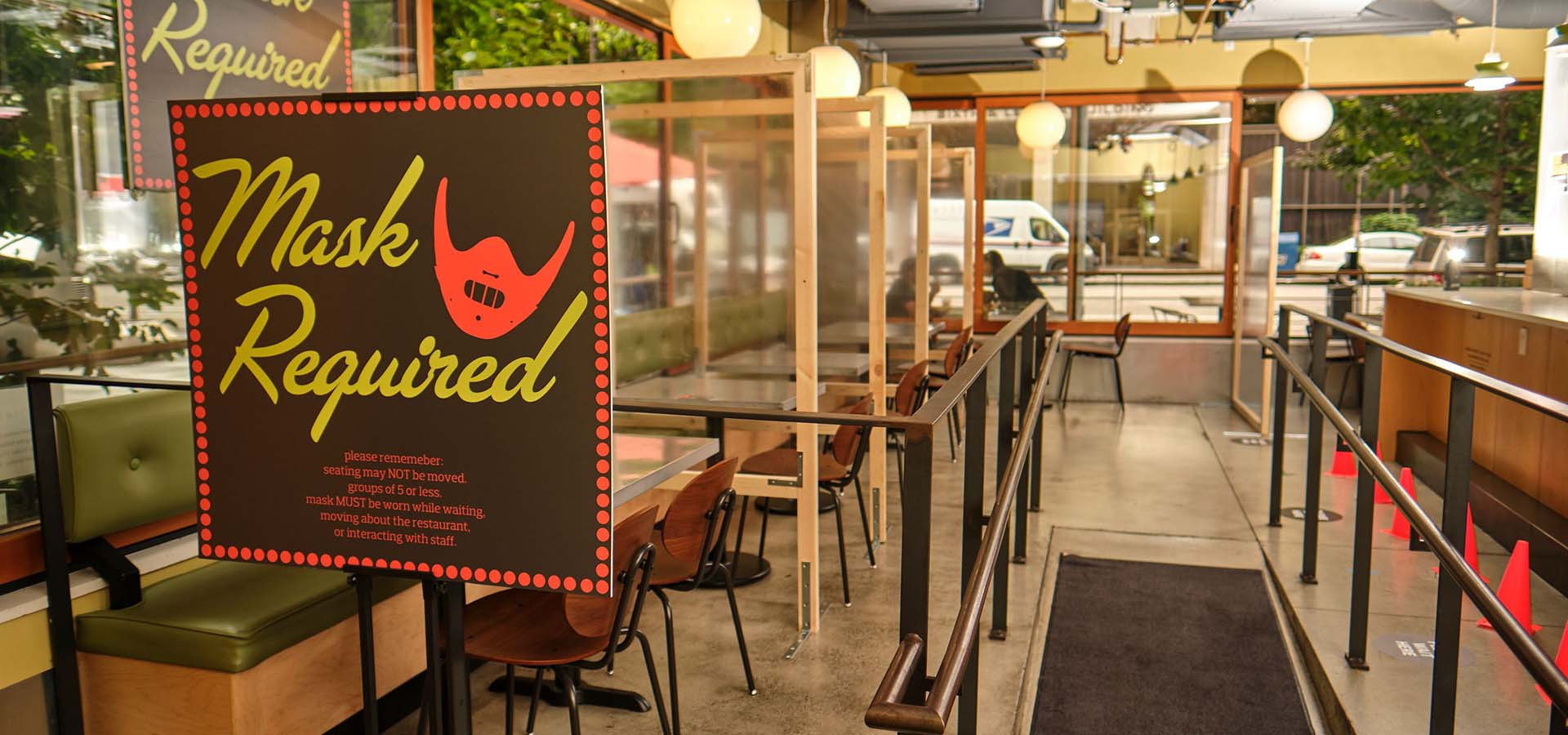 Interior of the Skillet restaurant with hostess sign indicating you must wear a mask.