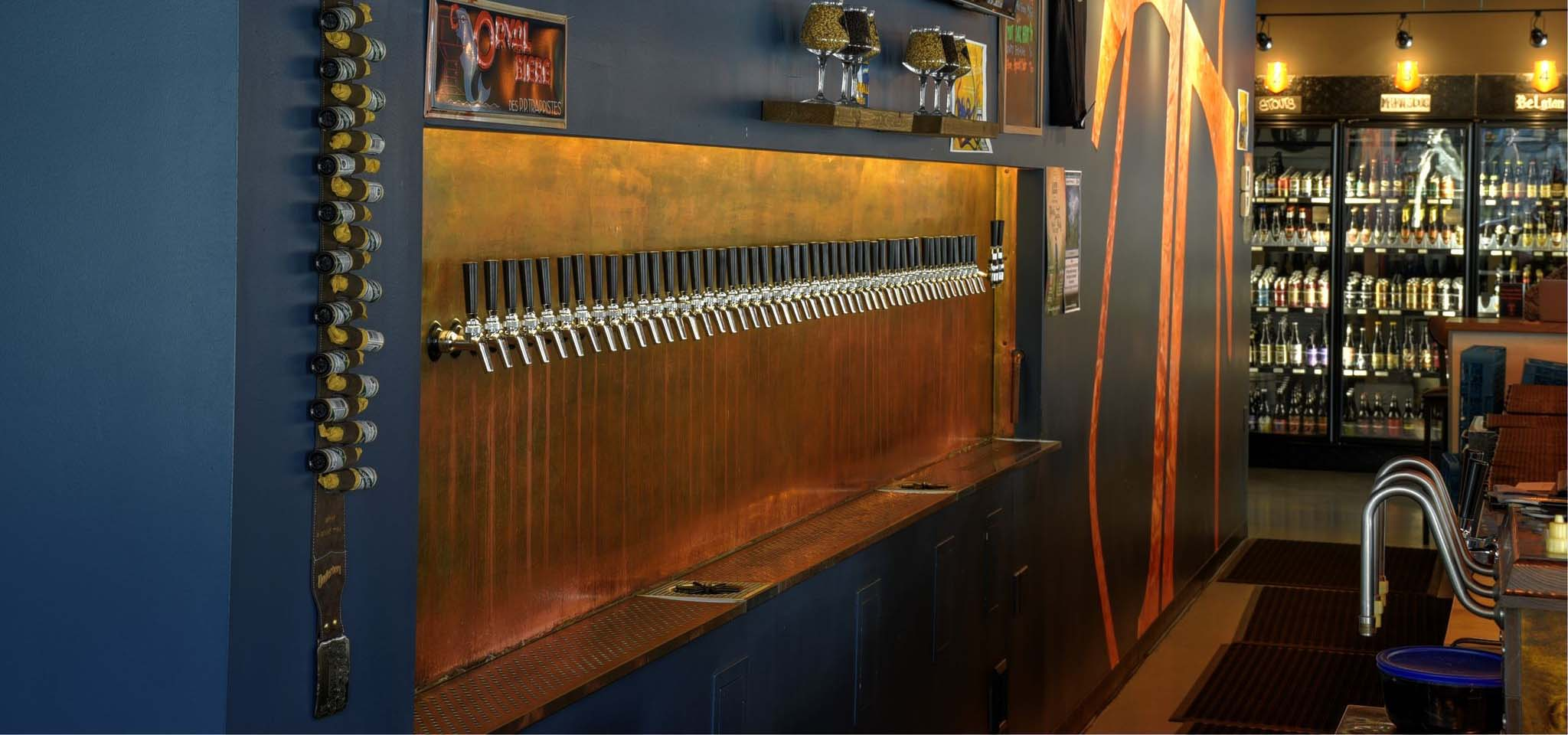 Beer taps in a row at a bar.