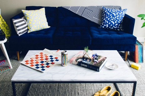living room scene with blue couch