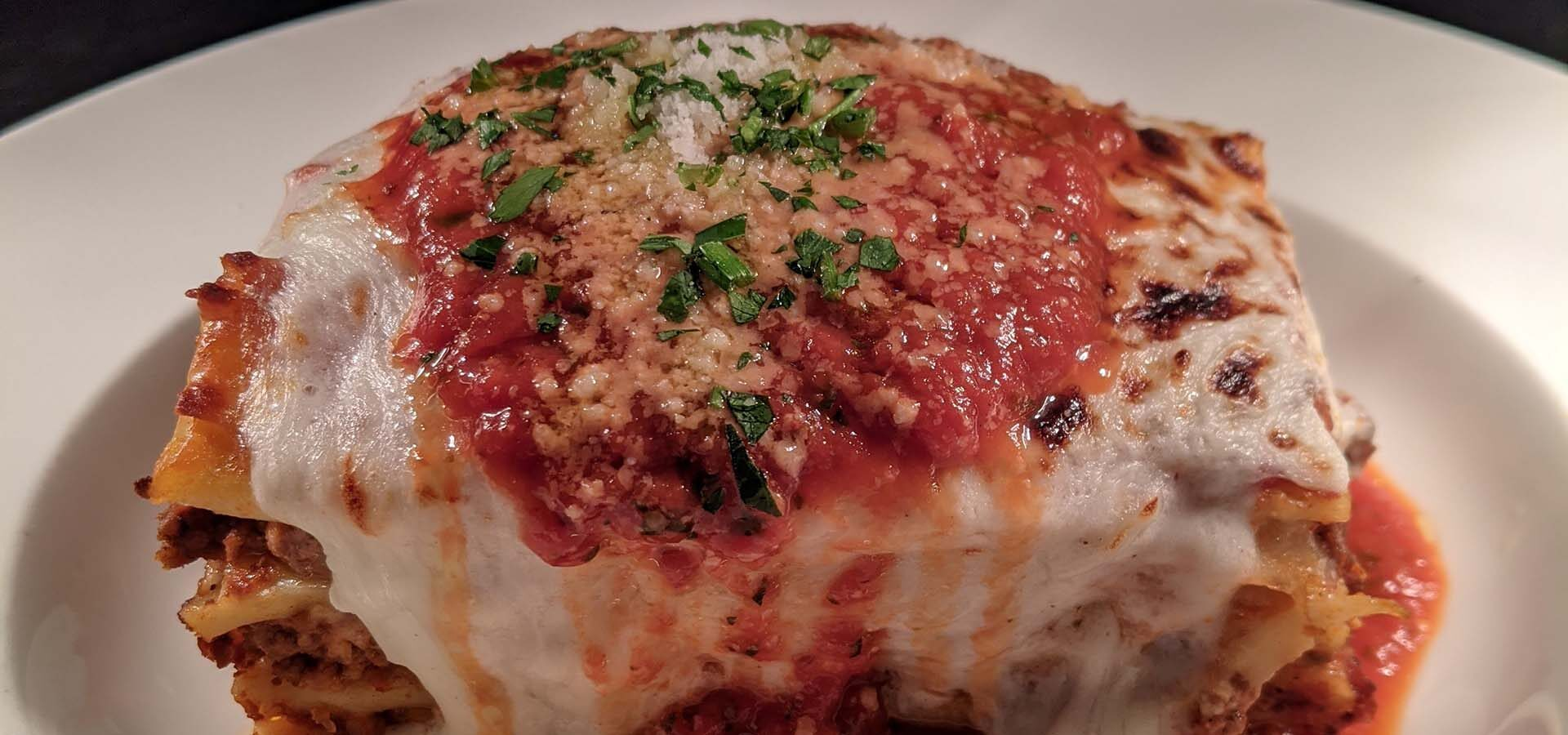 Plate of meat and cheese lasagna.
