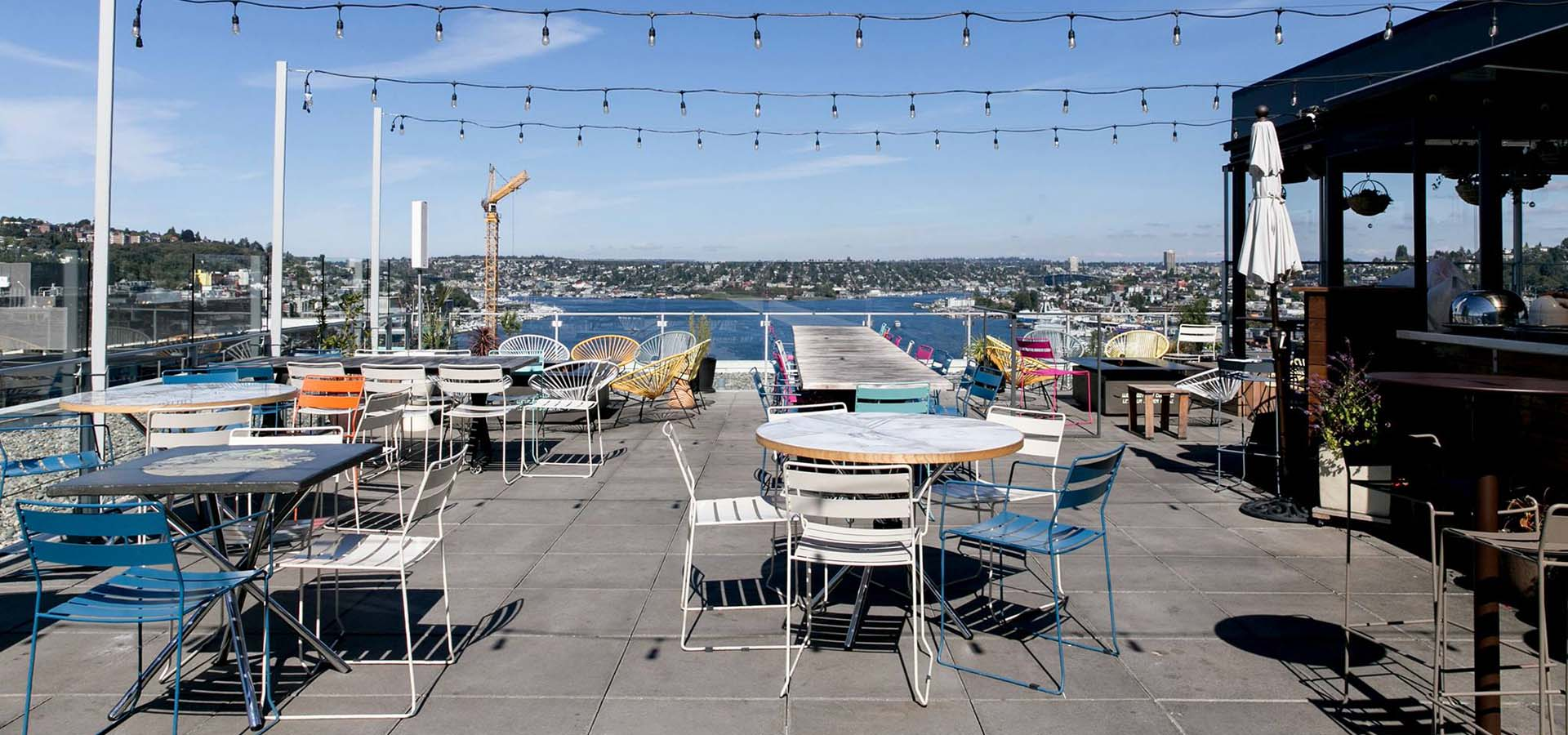 Restaurant outdoor rooftop patio with lake views.